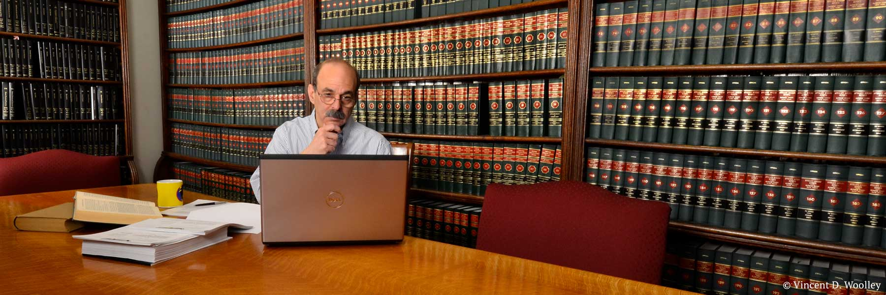 Warren County, New York attorney Neil H. Lebowitz conducting legal research in law library. Photographer: Vincent D. Woolley. Copyright owner-licensor: Vincent D. Woolley. Copyright licensee: Neil H. Lebowitz.